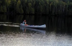 Paddling a canoe on a lake