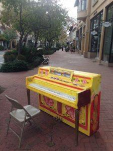Piano on a sidewalk