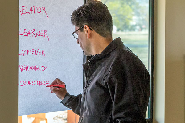 Man creating list of leadership strengths