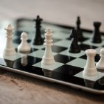 The Chess Game of Positive Meets Deliberative